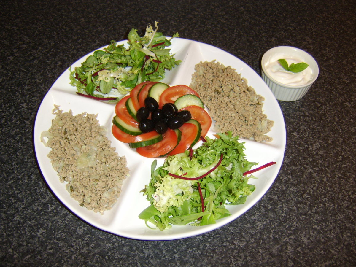 The minted lamb is served cold along with some fresh salad and garlic soured cream
