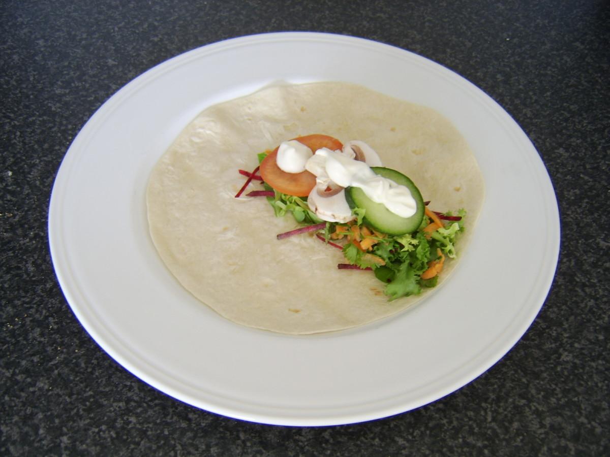 Assembling the vegetarian salad wrap