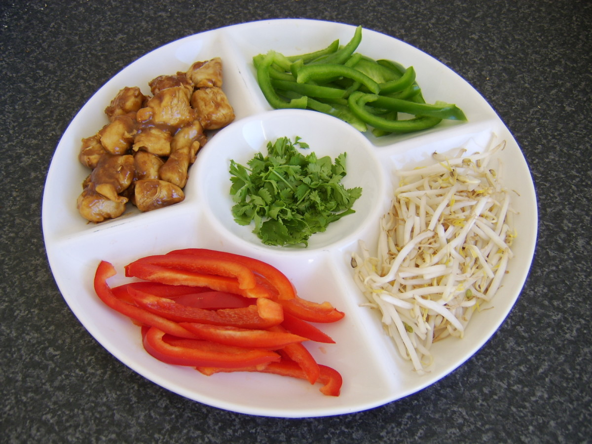 Chicken in chow mein sauce accompanied by a variety of crunchy vegetables.