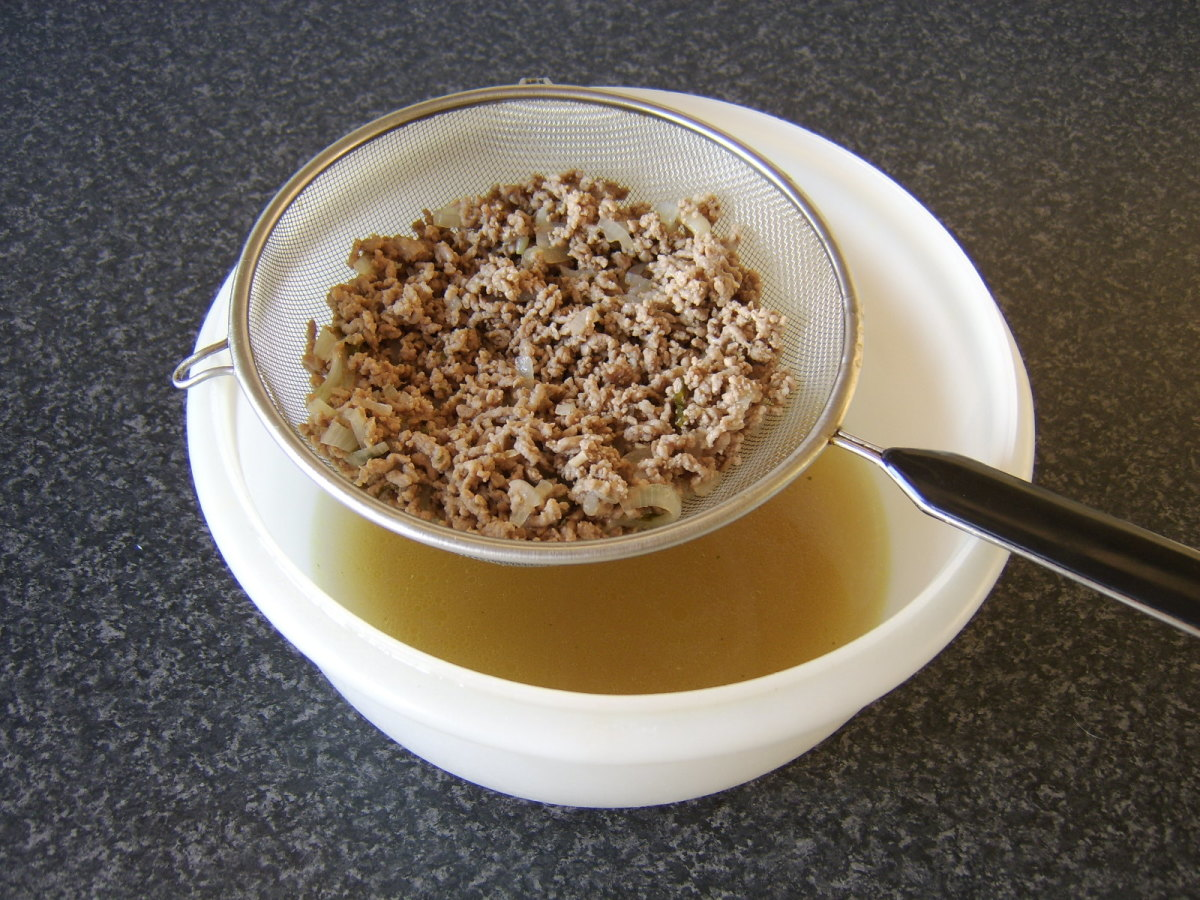 The cooled lamb mixture is drained through a sieve
