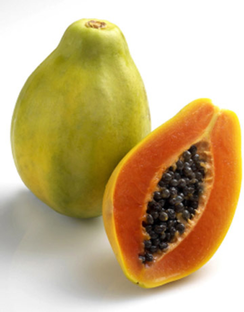 A papaya sliced in half. Remove the skin and seeds before eating!