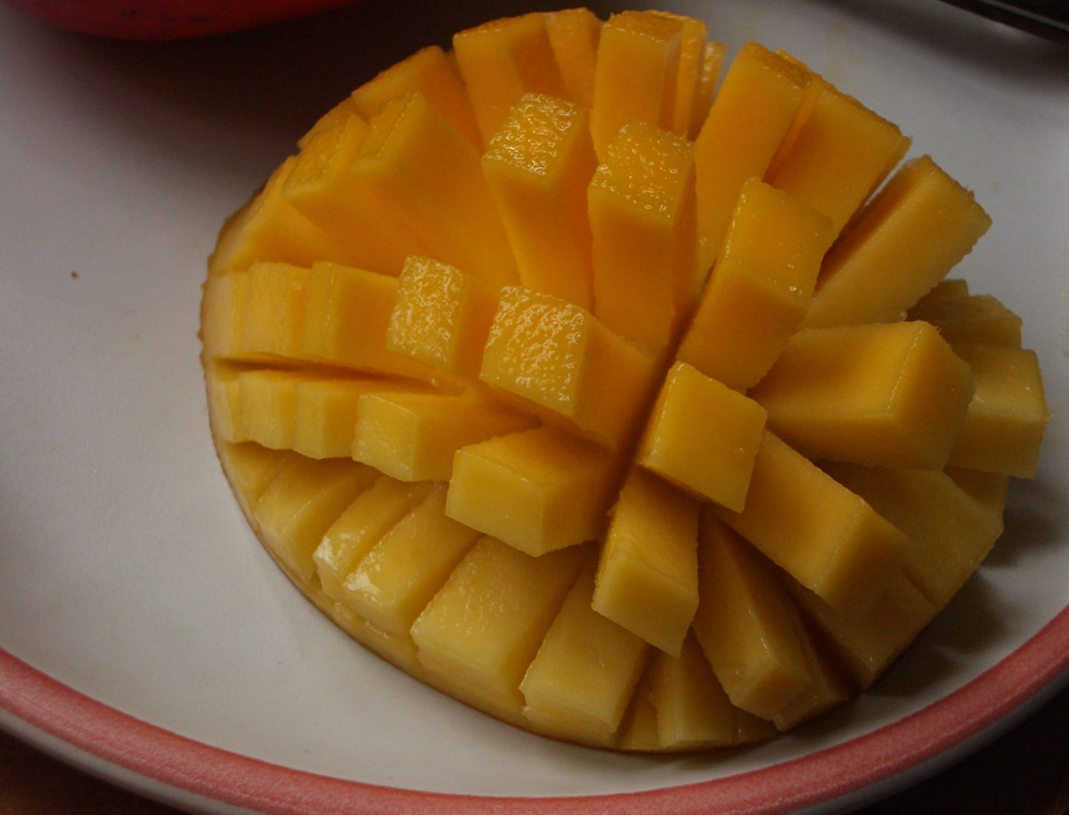 A sliced and cubed mango, ready to eat.