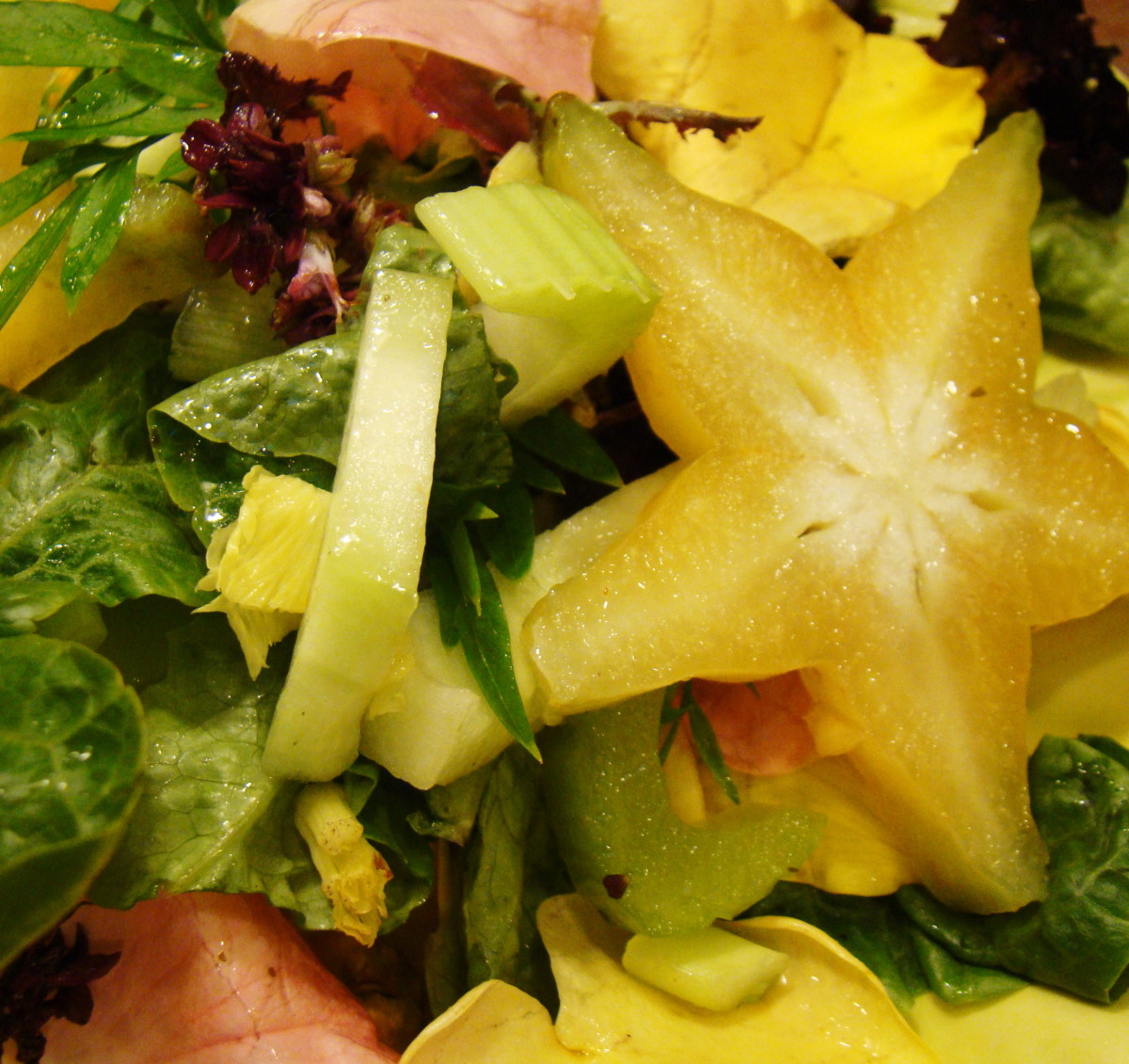A slice of starfruit served in a salad.