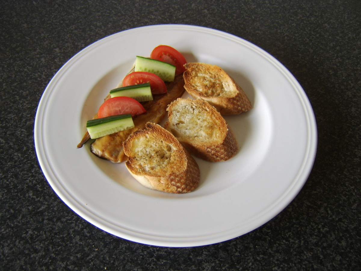 Bruschetta, tomato and cucumber are added to the plate
