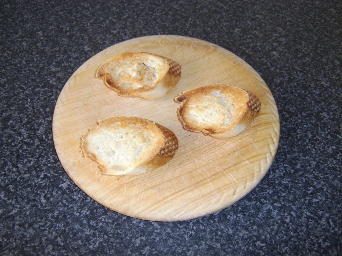 Toasted bread is rubbed with garlic, drizzled with olive oil and seasoned