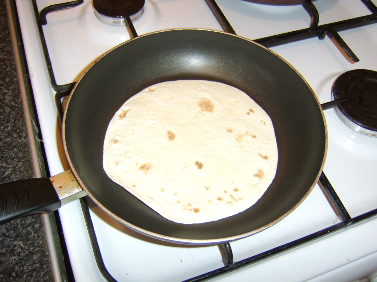 The tortilla wraps are heated in a dry frying pan
