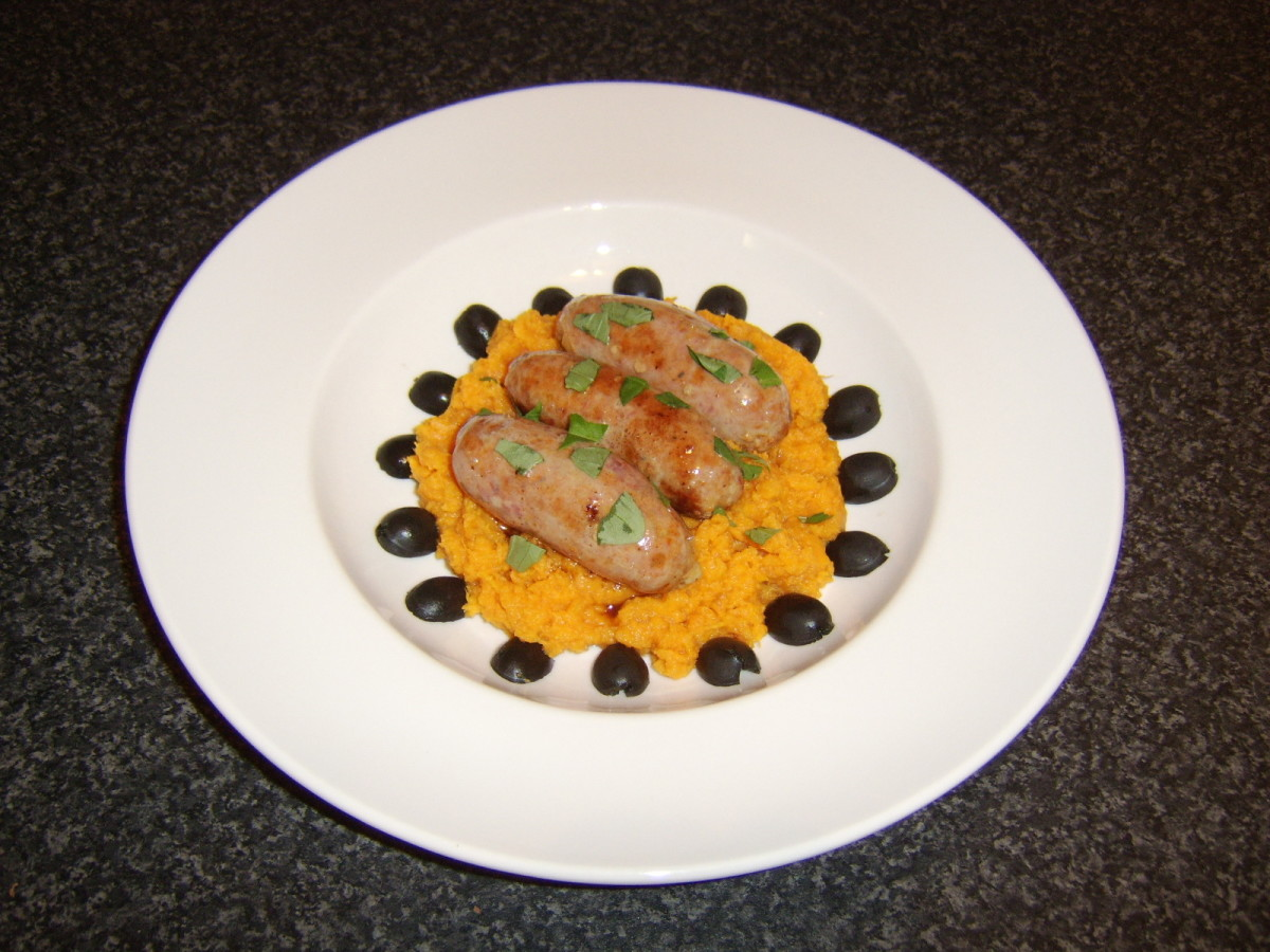 A ring of black olive halves make an attractive final garnish for this Mediterranean style bangers and mash