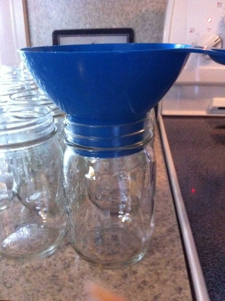 Funnel placed in canning jars for easier pouring