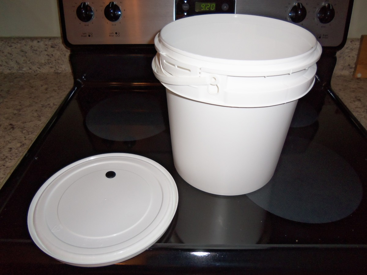 A brewing bucket with a tight-fitting lid and a hole for an airlock.
