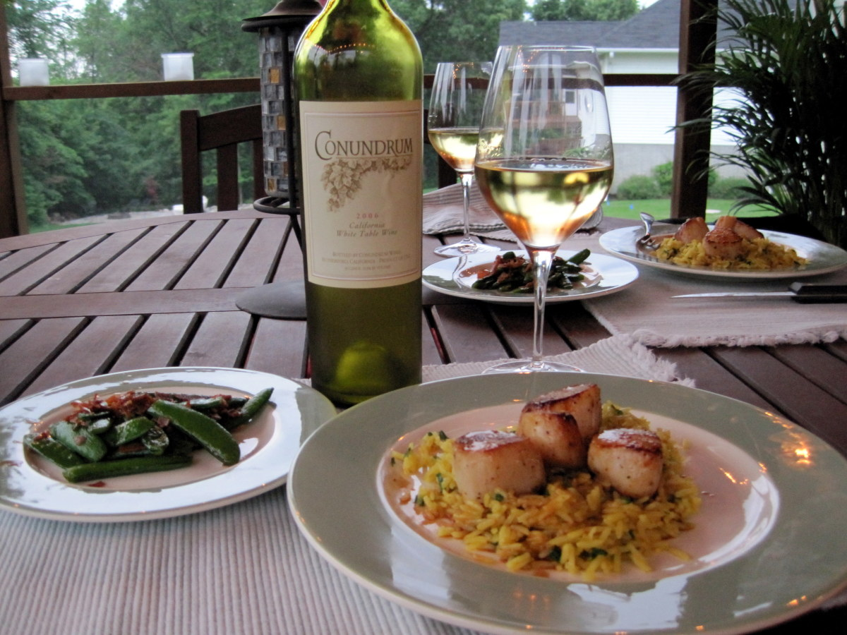Seared scallops with orange soy ginger sauce over curried rice, sugar snap peas with bacon