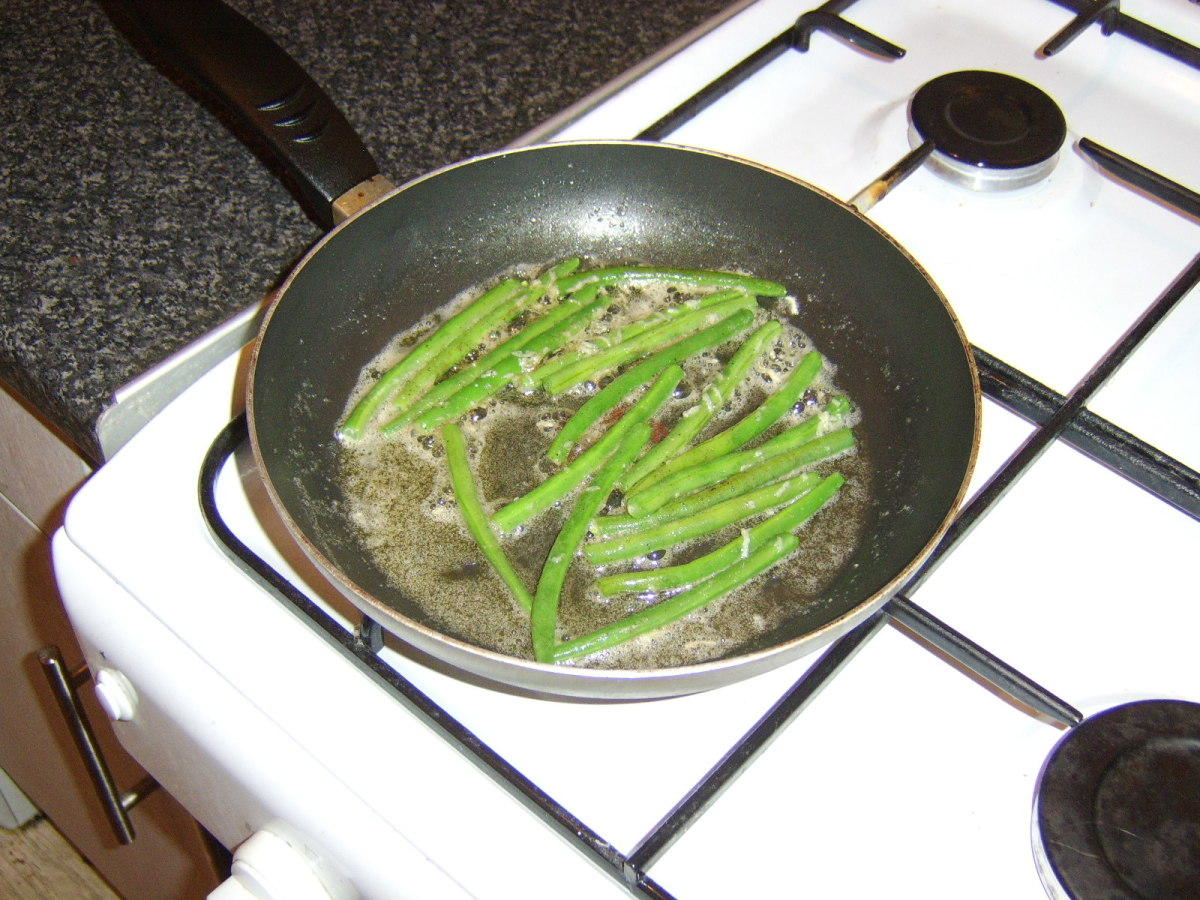 The green beans are fried in butter, garlic, sea salt and black pepper