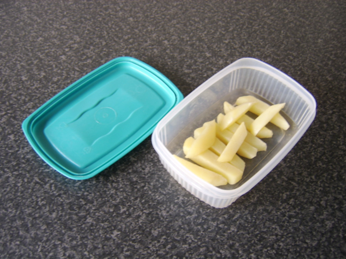 The parboiled chips are cooled and refrigerated in a plastic container