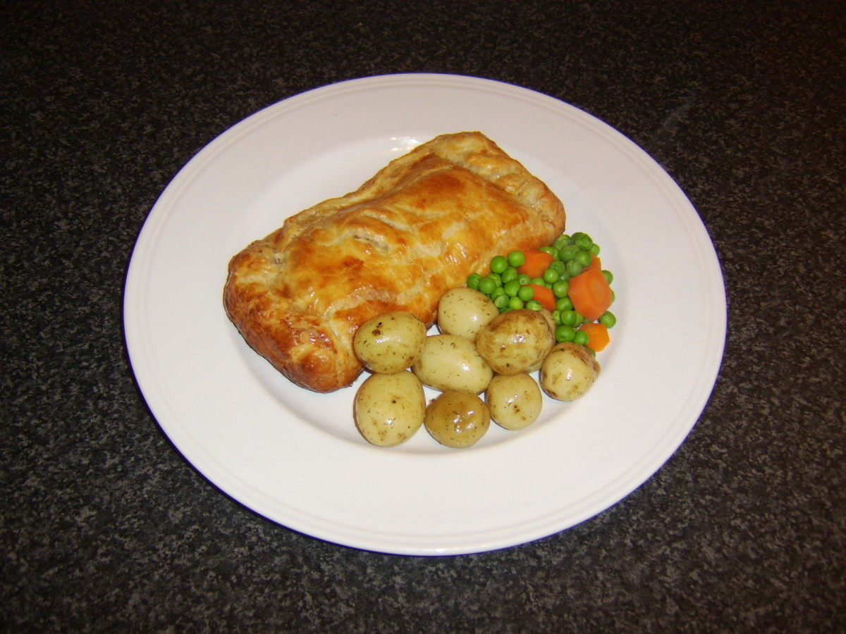 A fillet of fresh whiting is cooked in a puff pastry parcel and served with fresh assorted vegetables