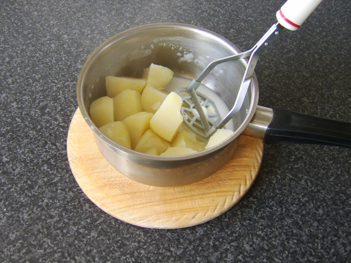 The potatoes are mashed with some of the remaining milk