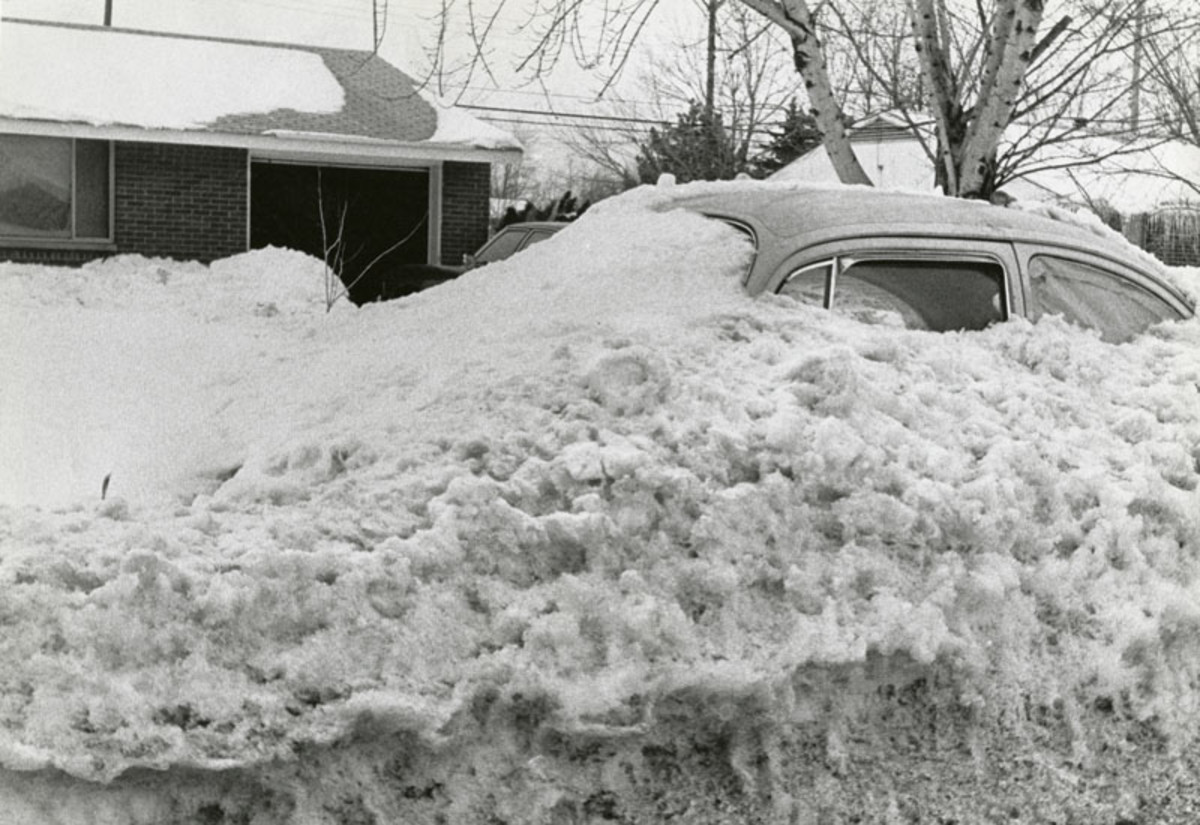Central Ohio, January 1978. This parked vehicle was covered by large snow plows wor5king the street.