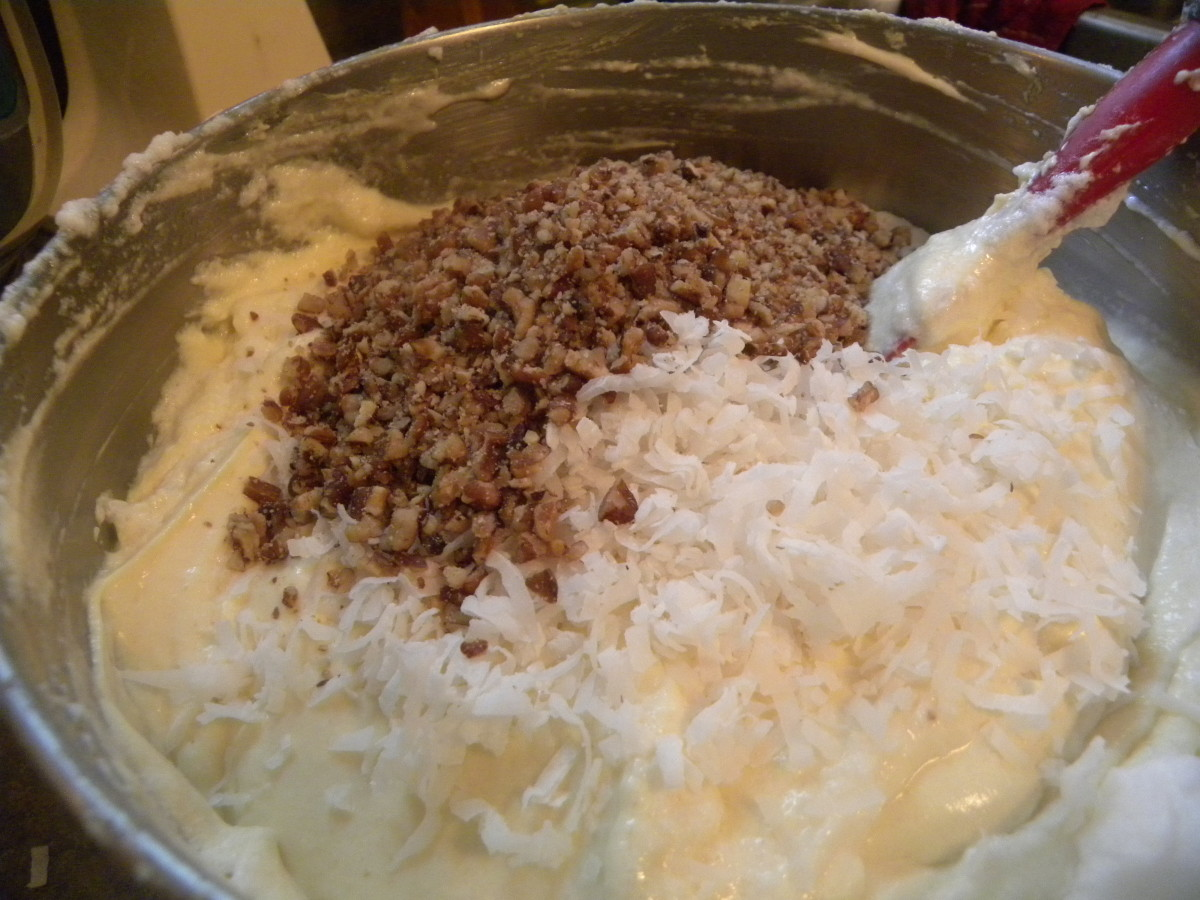 Pecans and coconut flakes added to the batter for Italian Cream Cake.