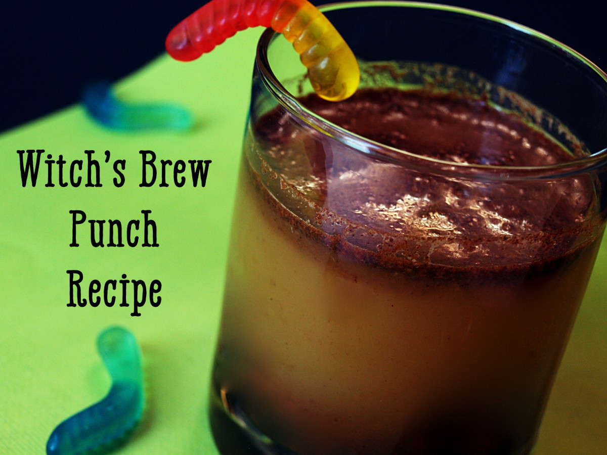 Witch's brew punch combines spices, cider, orange juice concentrate, and ginger ale for an eerily layered drink.