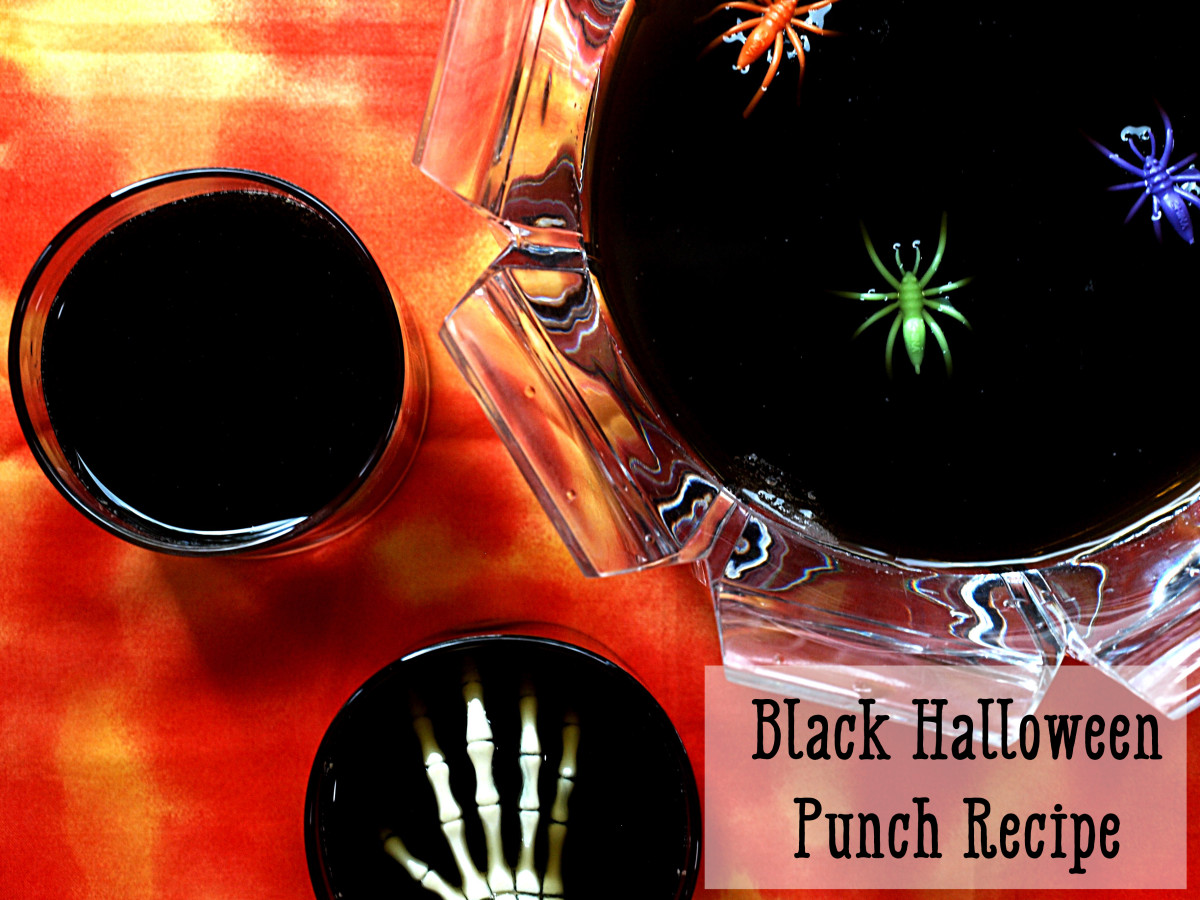 Spooky Black Halloween Punch mixes orange and grape drink mix with ginger ale.