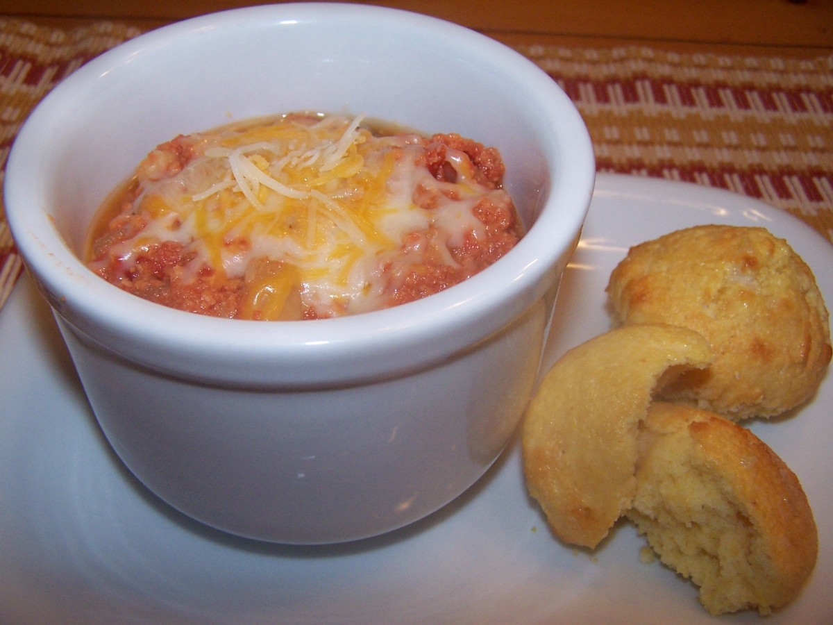 Turkey Chili served with cheese and warm cornbread muffins makes a tasty meal.