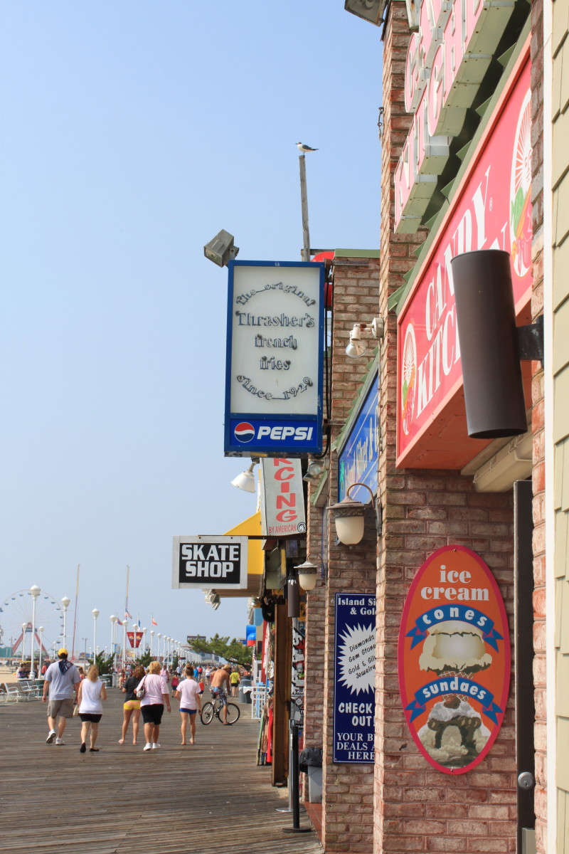Ocean City boardwalk with Thrasher fries and Candy Kitchen store fronts