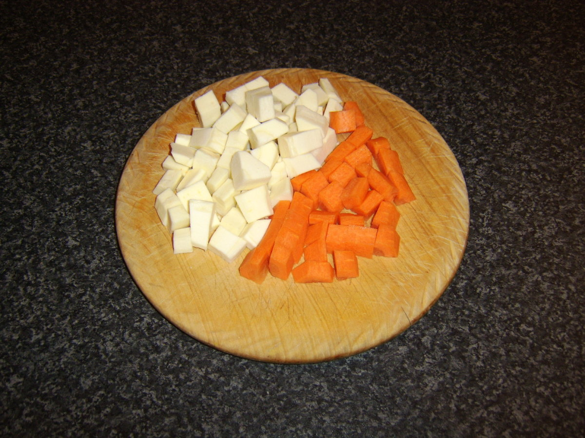 Carrot and parsnip are peeled and chopped to a medium dice