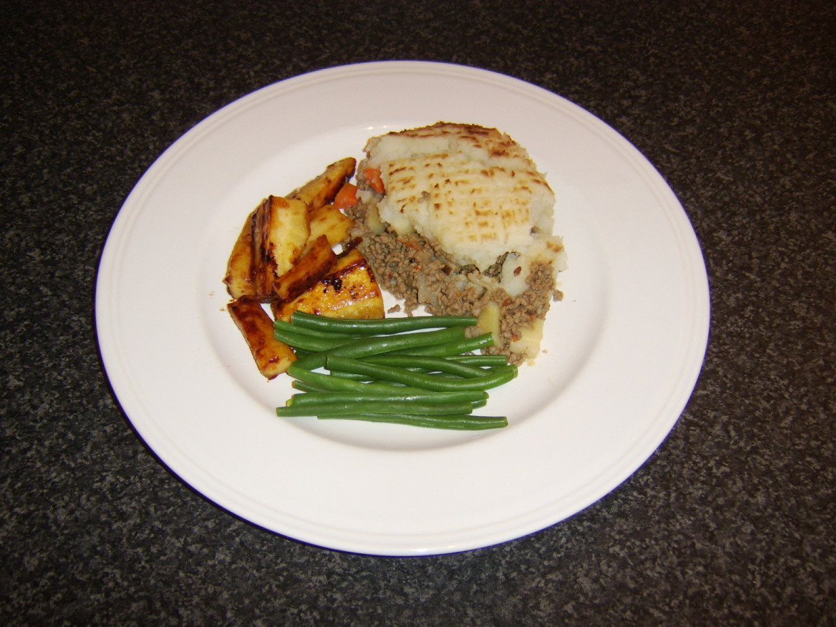 The whisky marmalade roast parsnips are served with a portion of cottage pie and blanched green beans