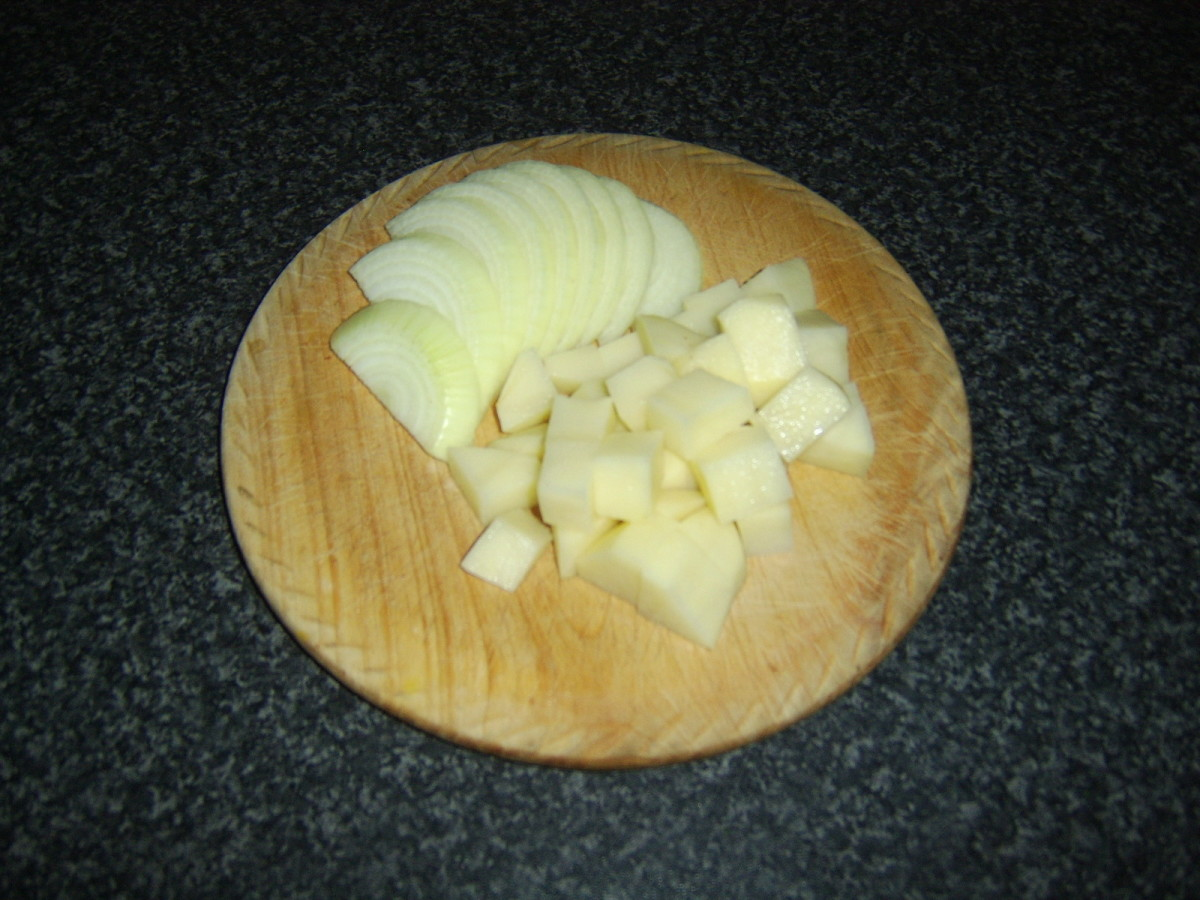 The onion is sliced and the potato is chopped before both are added to the beef and stock
