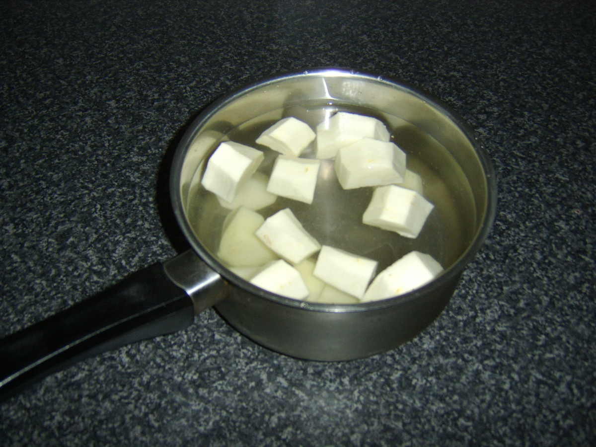 Potato and parsnip are peeled, chopped and added to cold, salted water