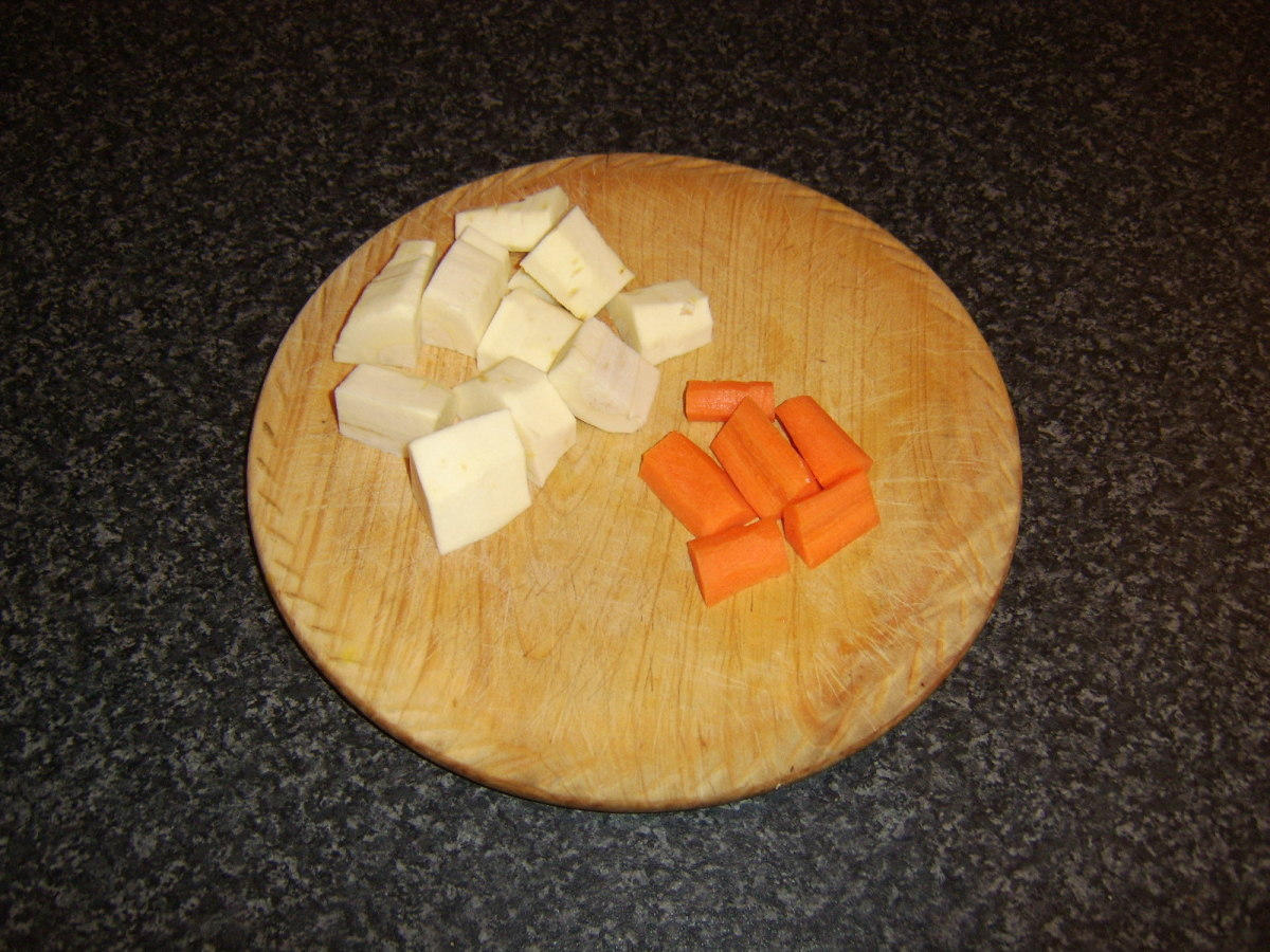 The chopped parsnip and carrot are the last ingredients to be added to the beef and root vegetable stew