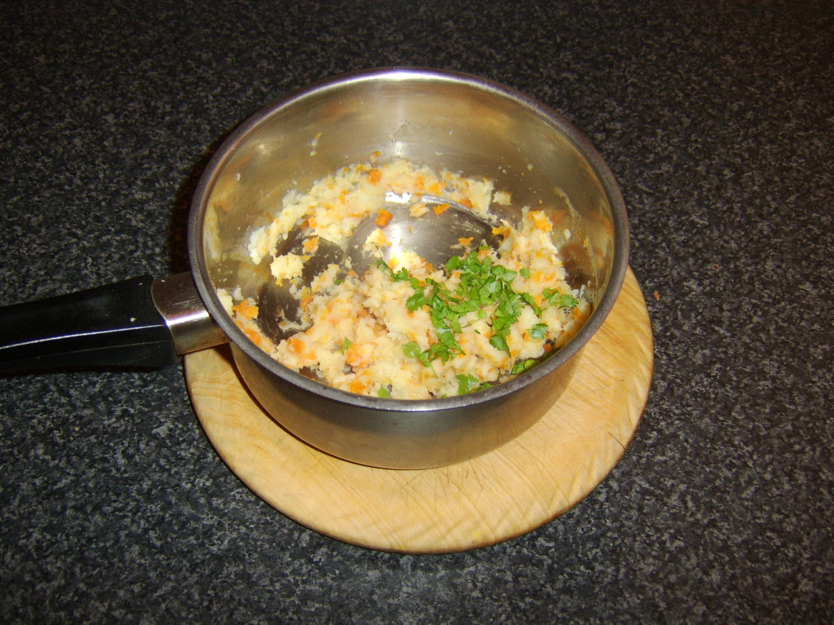 The parsnip and carrot should be mashed before the parsley is added