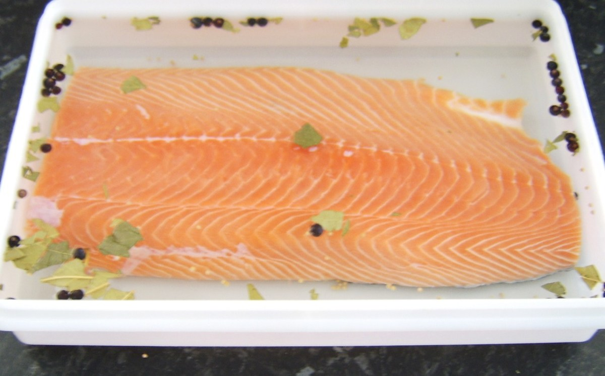 The salmon fillet is added to the brining solution