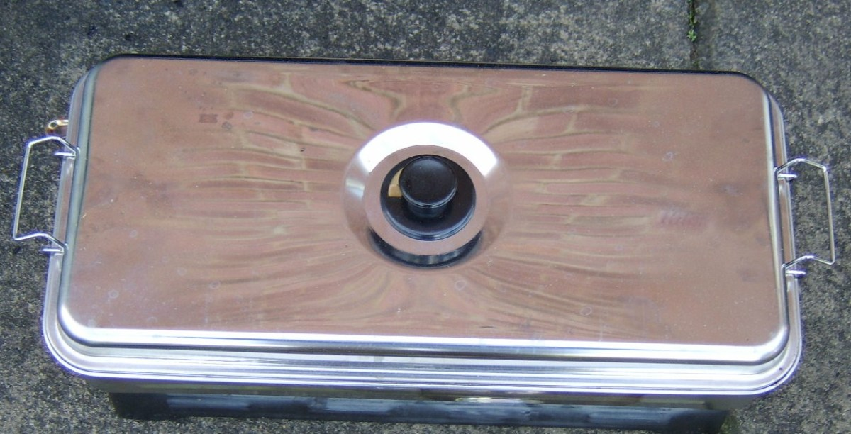 The lid is clipped on to the smoking compartment and it is laid on top of the burners