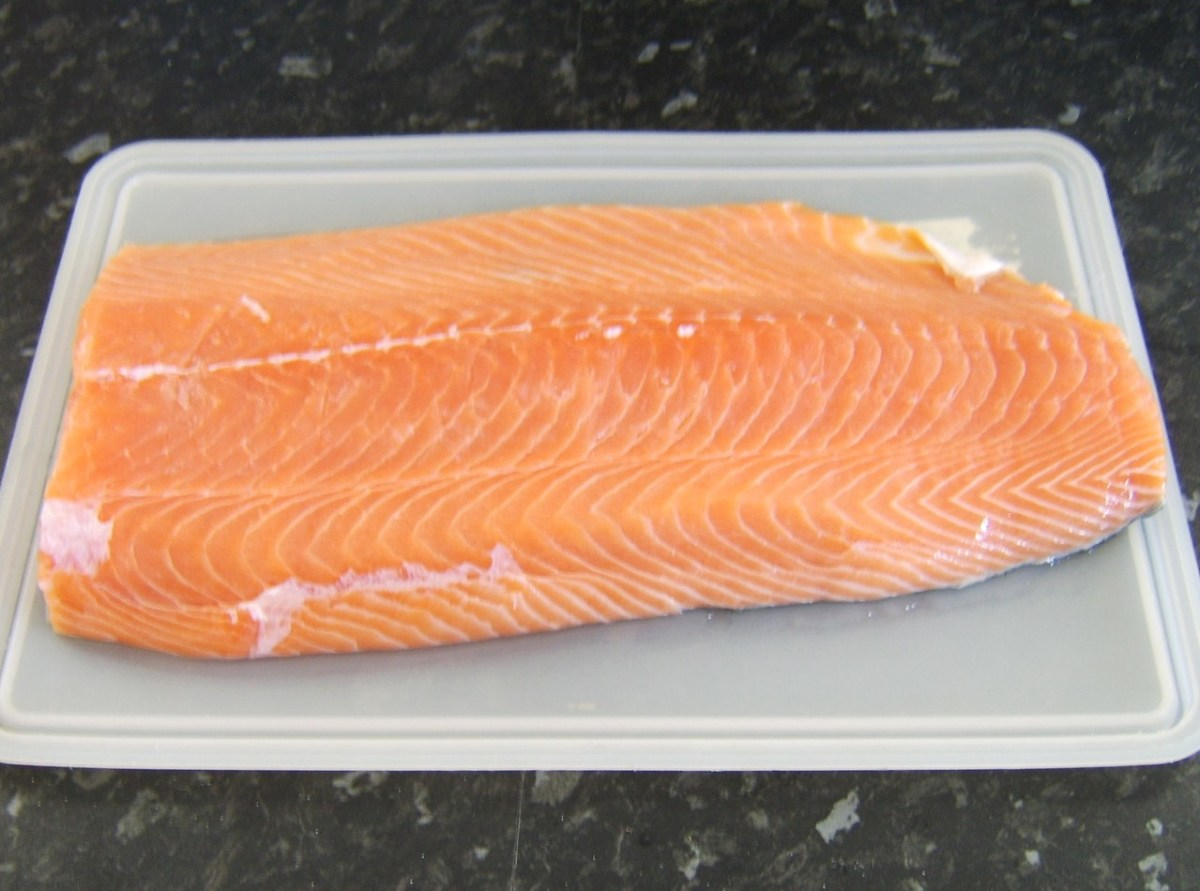The brined salmon fillet is rinsed in cold water and patted dry