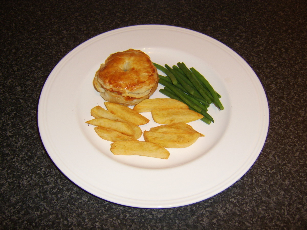 A homemade quail, bacon and mushroom puff pastry pie served with real chips and green beans