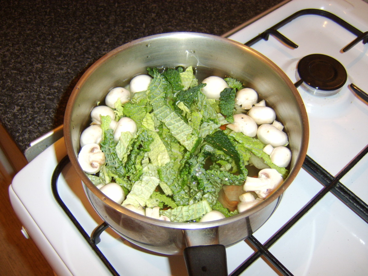 Chopped vegetables are added to the quail stock