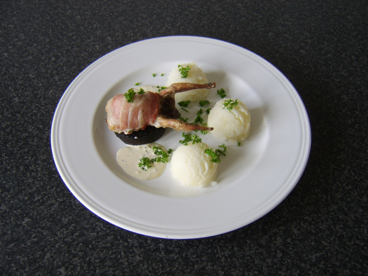 The quail is wrapped in bacon and roasted before being served on a slice of Stornoway black pudding with mashed potatoes and peppercorn cream sauce