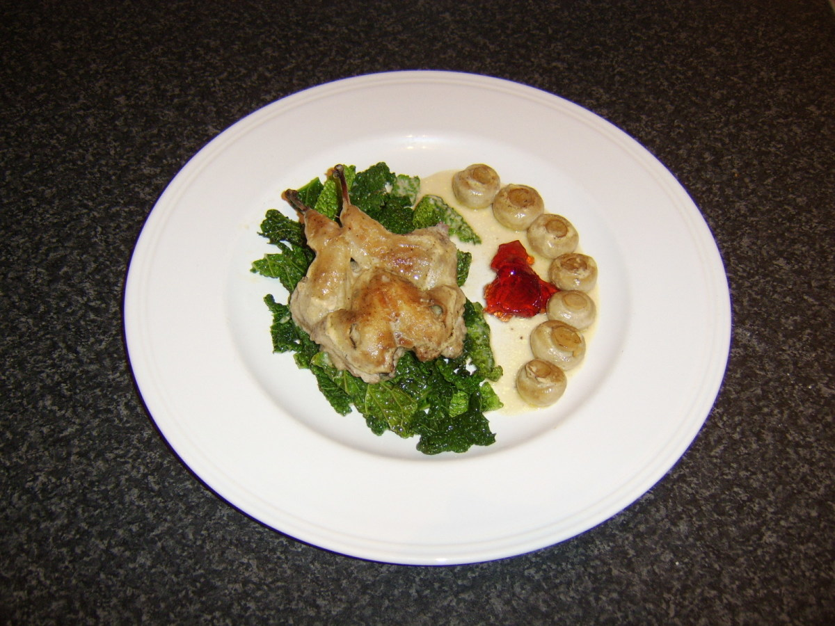 The quail has been casseroled in chicken stock, cream and mushrooms before being served on a bed of braised savoy cabbage.