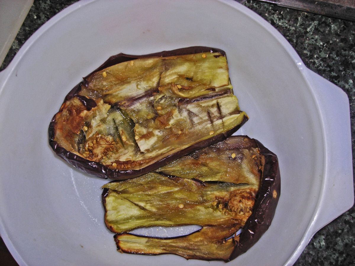 Eggplant or aubergine sliced in half and sprinkled with salt.