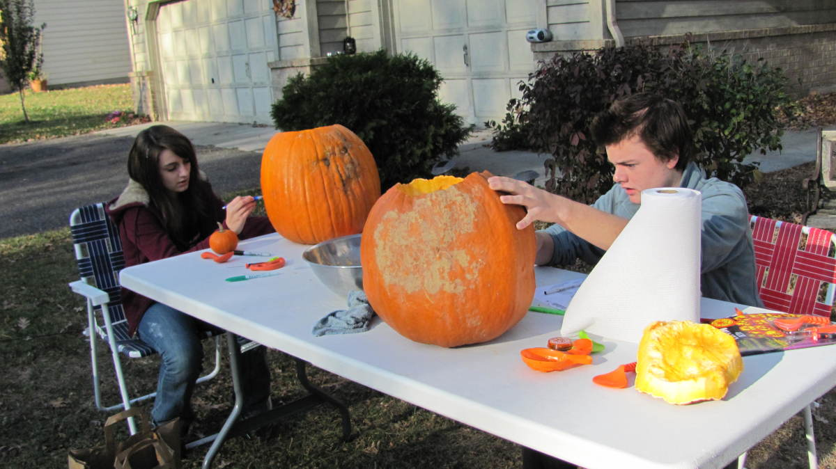 Carving their Pumpkins into Jack-O-Lanterns