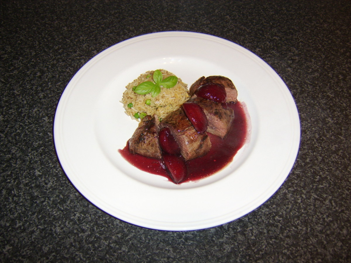 This oven roasted duck breast is sliced, topped with plum and ginger sauce and served with fried rice