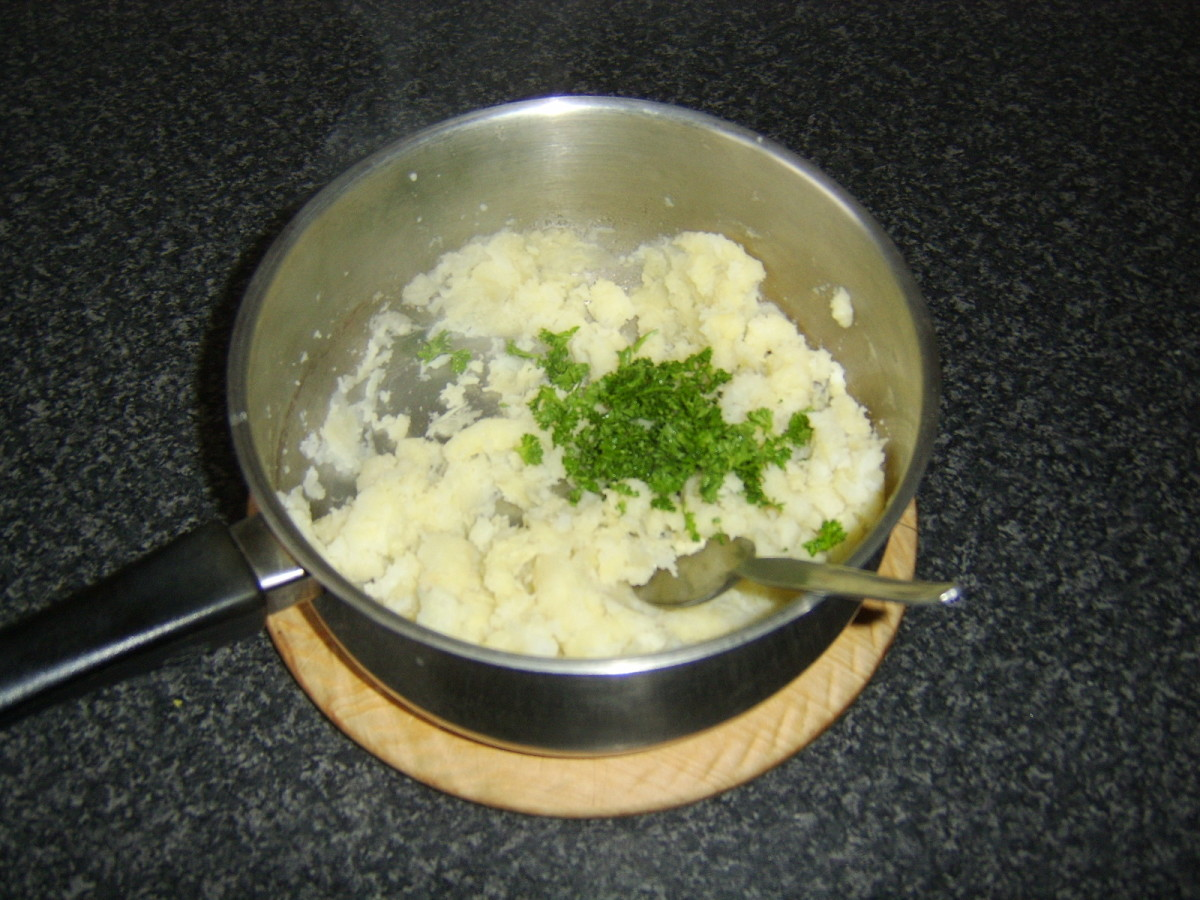 Parsley and garlic is stirred through the mash