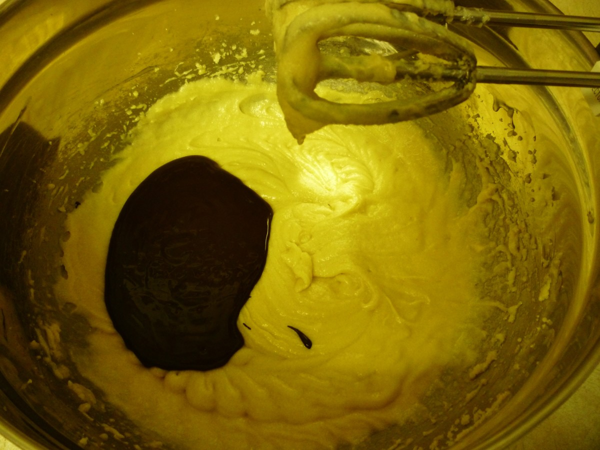 Melted chocolate being added to the cookie batter.