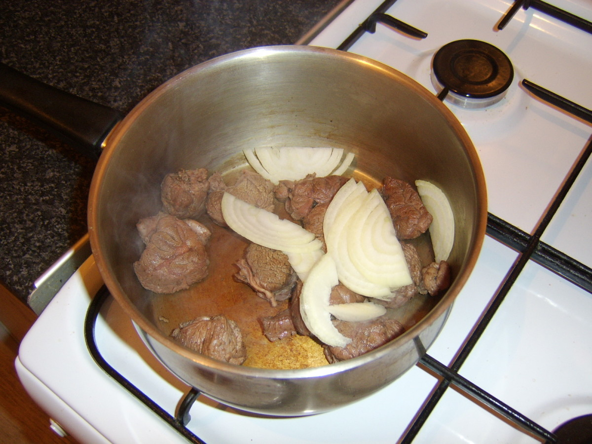 Sliced onion is added to the browned beef