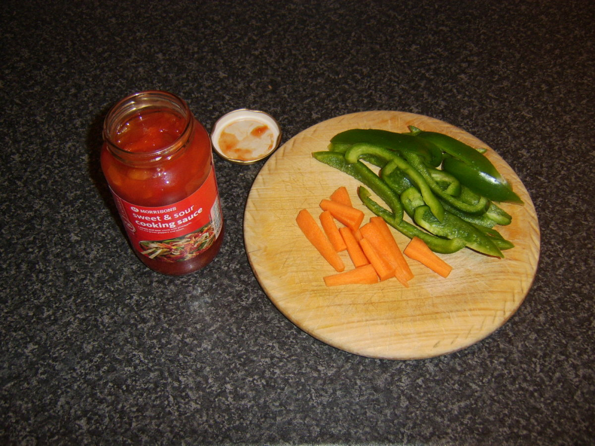 Sweet and sour sauce, carrot and green bell pepper ready to be added to the beef