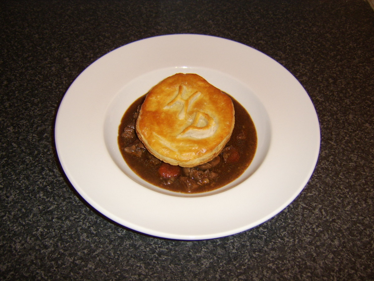 The beef steak and kidney stew is topped by a separately cooked disc of puff pastry