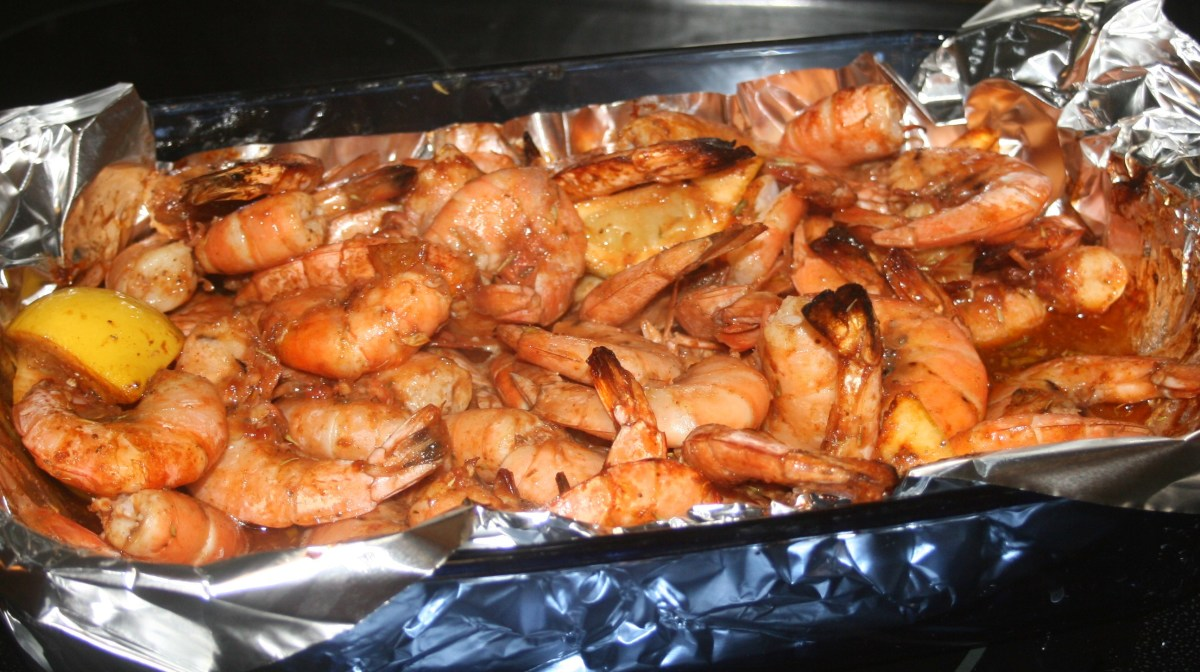 Bake the shrimp in a foil-lined baking pan for 30 to 40 minutes, turning every 10.