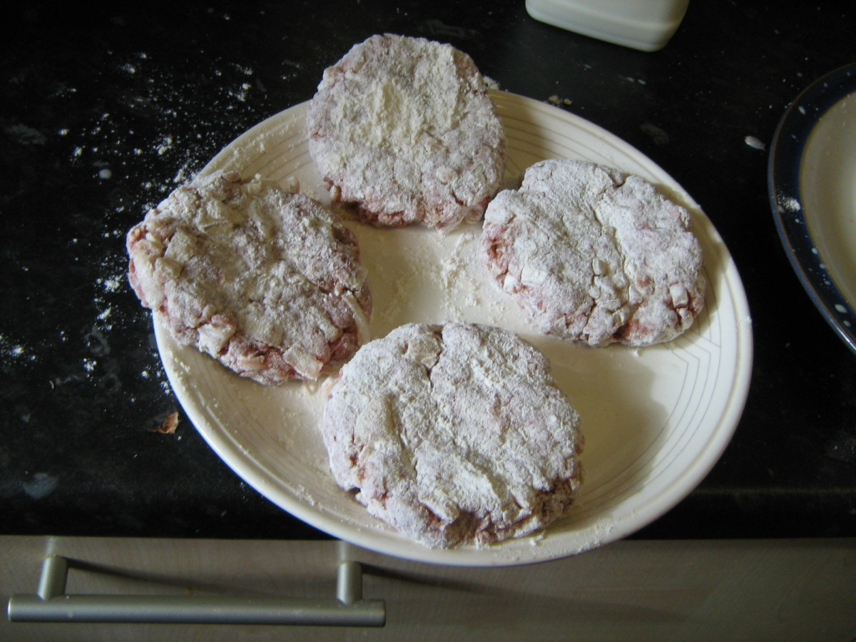 Place the wet balls onto a floured plate and flatten to the desired size. Pick up the loose flour and cover the tops of the burgers.