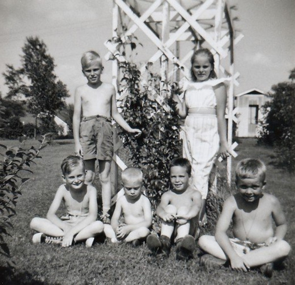 My 3 cousins and my 2 brothers both of whom are seated below me on the right.