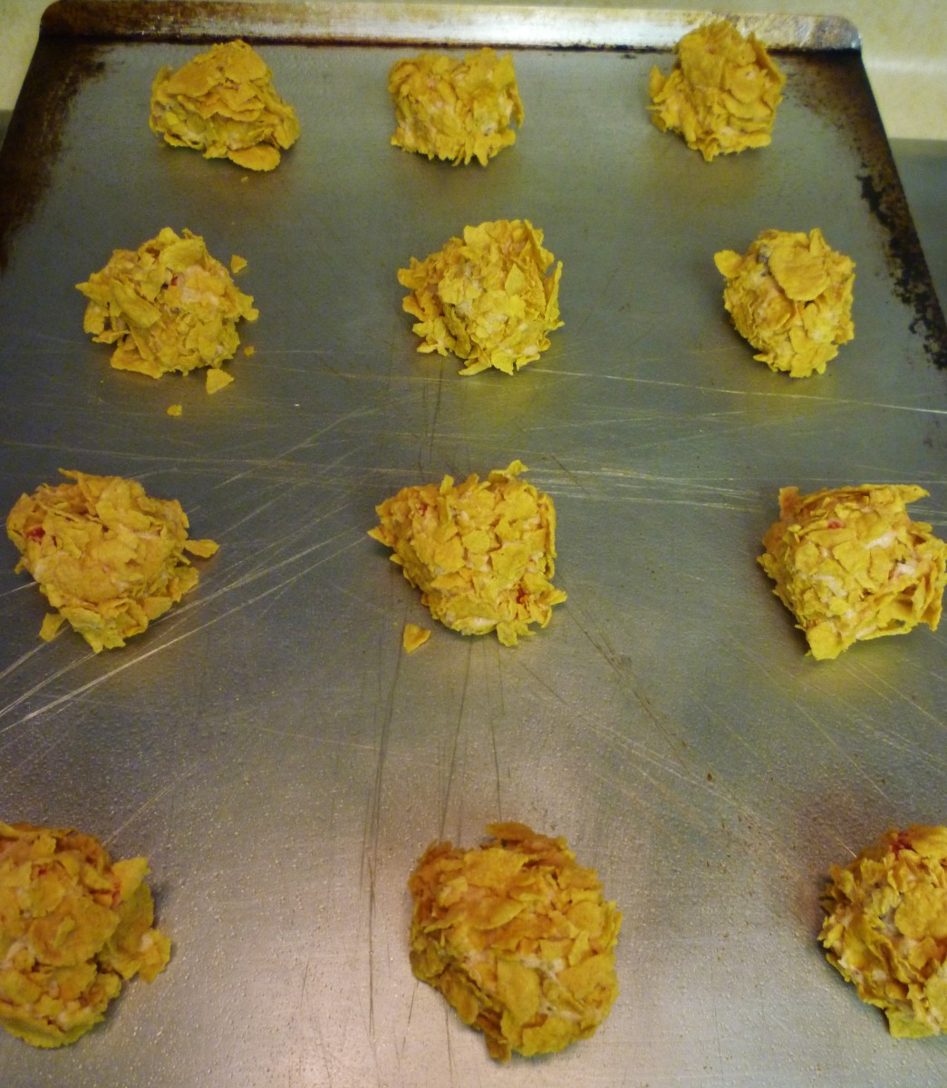 Cherry wink dough rolled in cornflakes and put onto greased cookie sheet.