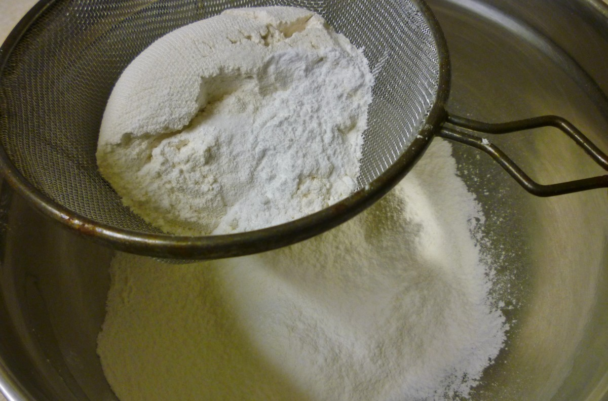 Sifting the flour, baking soda, baking powder and salt together into a bowl.